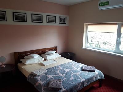 Изображение Двухместный номер (2-спальная и дополнительная кровать)